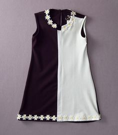 Adorable.  Another great dress for a little girl.  Love the retro aspect and daisy detail.