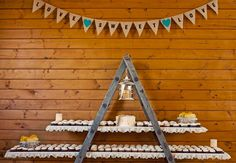 Rustic cupcake display with ladder.