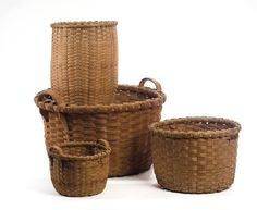 FOUR NEW ENGLAND SPLINT BASKETS INCLUDING TWO CORLISS SIGNED EXAMPLES.  Sold: $ 175  Height of largest, 12 ¾ inches, diameter 20 inches.