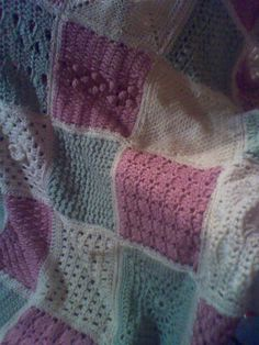Blanket I made for my oldest grand baby. each square is different, it came out soooooooo cute