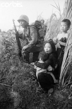 3/23/1966: Phu Cat, South Vietnam- A Vietnamese mother and her children cringe in terror as Korean troops sweep through a cane field here March 23 in pursuit of the Viet Cong. The Korean Tiger Division, conducting search-and-destroy operations. ~ Vietnam War