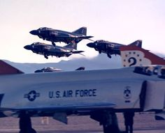 Blue Angels take off over Thunderbirds (all flying F4 Phantoms)