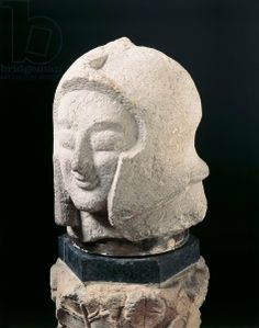 Colossal warrior head found in tomb in Orvieto, Terni. Etruscan civilization, 6th century b.C. Artwork-location: Florence, Museo Archeologico Nazionale (Archaeological Museum)