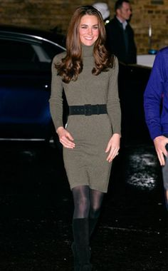 This formfitting green Ralph Lauren turtleneck dress paired with tights and knee-high boots looks fabulous on Her Royal Highness as she attends a charity function in England.