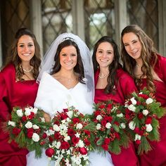 Real Weddings - In Bliss Weddings  The bridesmaids wore long red strapless ball gowns, with matching shurgs and opera gloves. Each carried a bouquet of winter greens, white and red roses, and hypericum berries. Colleen's bouquet was the same with the addition of stephanotis from their florist, Pear River Florist.
