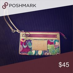 Coach wristlet Multi color Coach wristlet. Has been used. Can see a little wearing on the strap of the wristlet and on the gold zipper. Otherwise, no damage to the material. Great for summer! Coach Bags Clutches & Wristlets