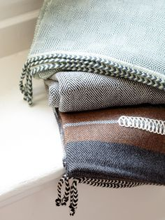 BLANKETS: Hand loomed by artisans in Peru, D. Bryant Archie's blankets are some of the softest on the market, made of baby alpaca and distinguished by the brand's signature braided trim.  Photo Credit: Brie Williams.