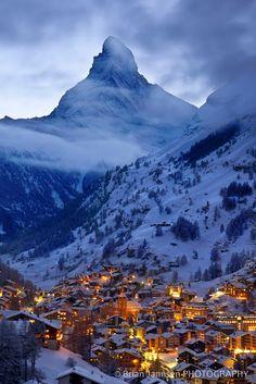 Enchanted Zermatt in Switzerland is aglow beneath the towering Matterhorn and Swiss Alps.