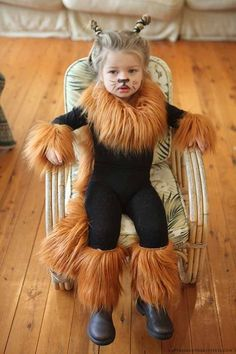 Easy lion costume. Black leotard and leggings with fur added.
