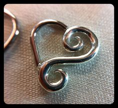 Beautiful Leroi Body Jewelry fancy hearts, perfect for a daith or other ear piercing! Come get yours at Tattoo Charlie's Preston Hwy