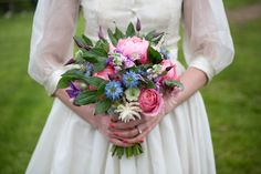 Bridal bouquet of peonies, clematis and cornflowers. Fairynuff Flowers