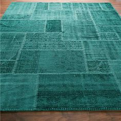 Turquoise dyed antique oushak rug in patchwork pattern