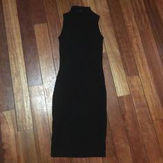 Ribbed Mock Neck Sleeveless Bodycon Midi Dress Black Ribbed Mock Neck Sleeveless Bodycon Midi Dress! Super soft! 95% Rayon 5% Spandex/Elastane. Brand new! Never worn! Wear with a baseball cap and Converse for the sporty look.  Forever 21 Dresses Midi