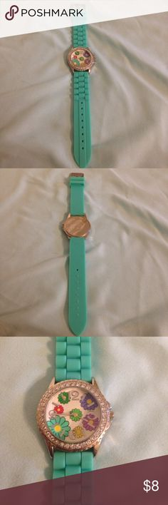Mint green flower watch Used mint green flower watch with jewels around the face.  It needs a new battery. Jewelry