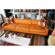 Orange couch. Yes please.
