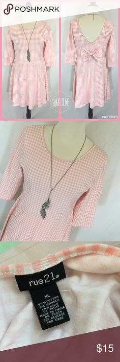 Adorable pink gingham skater dress Adorable pink and white gingham plaid skater dress from Rue 21 size extra large. cotton knit 35 inch waist. 33 inches long 17 inches armpit to armpit. Super cute bow on back Rue 21 Dresses