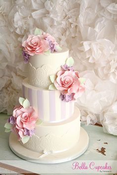 Lace & Stripes Wedding Cake but all cream and no flowers. with bow and brooch