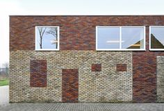 Westvleteren Community Center / Atelier Tom Vanhee Belgium The use of different types of bricks betray the successive renovations in the past. The new added walls in contemporary bricks build in the recent renovation strengthens the patchwork of different bricks.
