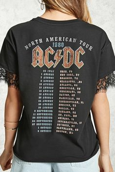 "A knit tour tee with a crew neckline, an ""ACDC"" graphic on the front and back, a tour list graphic at the back, lace detailing on the sleeves, and a raw-cut hem.<p>- Officially licensed product</p>"