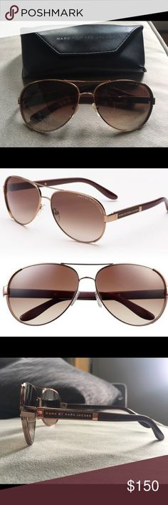 Marc by Marc Jacobs Aviators Gently used. Great condition. Come with original protective case.  Frame Material: Metal Lens Material: Plastic Lens Width: 64mm Bridge: 10mm Arm: 125mm Made in Italy Protection: 100% UV These are an oversize rimless metal aviator with a double bridge. This pair features adjustable nose pads and wire core adjustable plastic temples for extreme comfort. The Marc Jacobs logo is engraved on the temples. They also have lightweight scratch resistant/impact resistant…