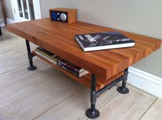 """Cherry coffee table, modern industrial style featuring butcher block top and steel pipe legs, 20"""" x 44""""."""