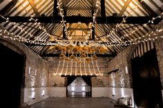 Warm white uplighting with fairy lights and butterscotch pom poms for an elegant, gold scheme Barn Wedding Lighting, Event Lighting, Barn Lighting, Outdoor Lighting, Lighting Design, Canopy Lights, Light Canopy, Mood Light, Paper Lanterns
