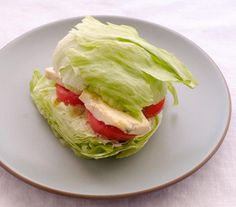 This simple, delicious combination is basically just our favorite salad in sandwich form. Firm, crisp iceberg lettuce holds its shape fantastically when sliced, and the tomato and blue cheese that usually dress the salad are turned into fillings. A drizzle of vinegar takes the place of a regular salad dressing.