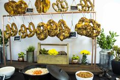 Paramount Catering and Events in Chicago offers whimsical pretzel ­stations. The pretzels hang on stands, and guests dip them in sauces, including whole-grain mustard and tomato-bacon jam.   Photo: Courtesy of Paramount Catering and Events