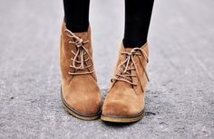 Lace-up wedge booties.