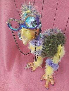 Mythical bird.Papier mache and novelty yarn