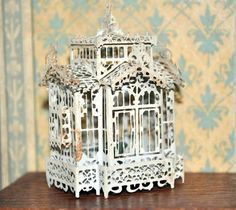 Antique dollhouse bird cage: painted tin, contains pair of love birds, 1½ inches wide