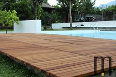 Platform in natural iroko wood for pool Pedana solarium in legno iroko Designed by Arch. Antonio Ciniglio New posting on our site! Please click here http://www.mazzocca.org/home/galleria/arredo-esterni to see additional photos.