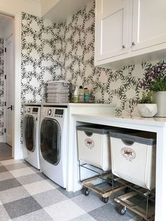 Laundry room with white cabinets, gray buffalo check floor, floral wallpaper