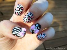 Love these! Black, white and pink leopard and zebra print nail art with bows.