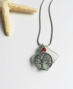 A personal favorite from my Etsy shop https://www.etsy.com/listing/233776060/sliver-family-tree-charm-charm-necklace