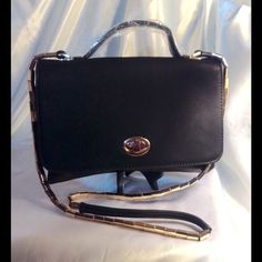Black Handbag This small flat handbag features top handle and removable gold snake design strap. Features inside pockets and one exterior zipper pocket. Measures: 10 inches wide 8 inches high. (This closet does not trade or use PayPal) Bags Mini Bags