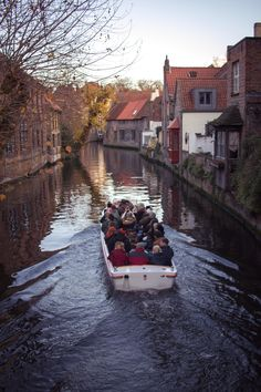 Boat on the canal at sunset in Brugge (Bruges), Belgium in winter for Christmas