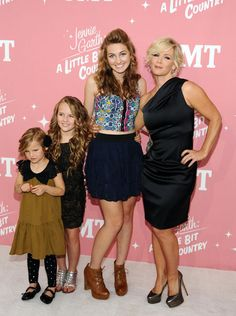 Jennie Garth & her girls at the CMT premiere party for A Little Bit Country. Check out Jennie's David Meister dress and Luca's top from UO!