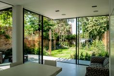 Killieser Avenue Project: sliding glass doors and frameless glass roof to rear extension in SW London Aluminium Sliding Doors, Sliding Door Systems, Sliding Glass Door, Corner Bifold Doors, Corner Door, Corner Windows, Glass Extension, Rear Extension, Extension Ideas