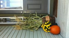Outdoor fall display with corn stocks- simple but cute