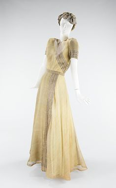 Evening dress by Mainbocher, 1947. Silk & metal. This piece is an interpretation of an Indian sari. From the collections of the Metropolitan Museum of Art.