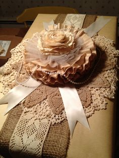 Coffee filter flower, burlap & dollies with brown craft wrap. Love the mixed textures. <3