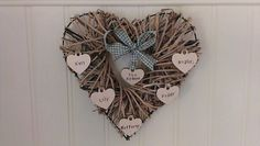 "Wicker ""family"" heart hung with hand-stamped names on wooden hearts & decorative ribbon by @PimmsCottageCrafts 