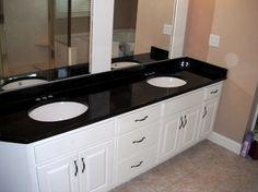 Subway tile back splash , white cabinets, nickel hardware, black granite  counters, and golden hardwood floirs | Kitchen |