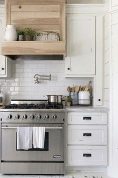 Modern Farmhouse by Beautiful Chaos modern farmhouse kitchen stove White Farmhouse Kitchens, Farmhouse Kitchen Decor, Home Decor Kitchen, Kitchen Furniture, Home Kitchens, Kitchen Ideas, Apartment Kitchen, Rustic Farmhouse, Farmhouse Style