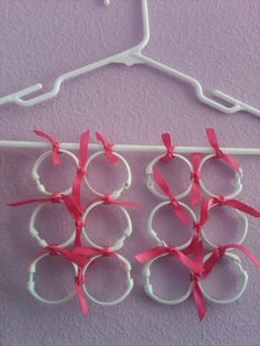 shower curtain rings + coat hangar = scarf organizer!  Good for those of us who have many scarves!