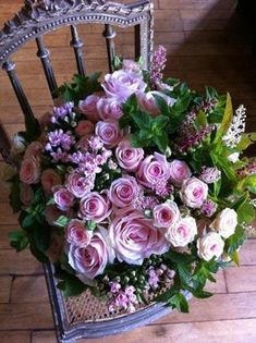 gorgeous pink rose bouquet on a violet chair.