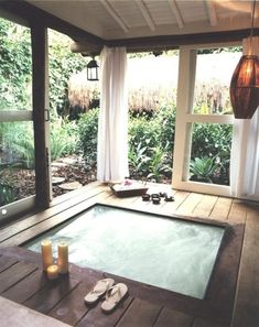 Off the master - hot tub with big sliding windows that open outside..YES! BUT- I'd want a glass ceiling to see the stars...