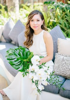 Tropical orchid + greenery bouquet for the bride