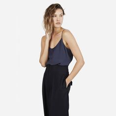 A feminine, clean-cut camisole in silk. The fabric is a washed crepe-de-chine that shows a subtle lustre on darker colors. The camisole features adjustable dyed-to-match sliders on straps.